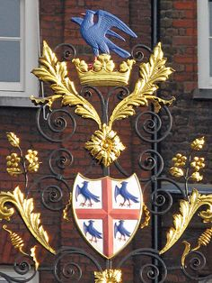 Heraldic gate, College of Arms    This is curious for me as I have some antique pieces from Ireland with THAT BIRD, exactly as pictured on the top part of the crown. MsMaine