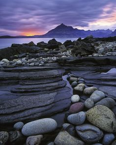 Rocks, water, mountains, sunset