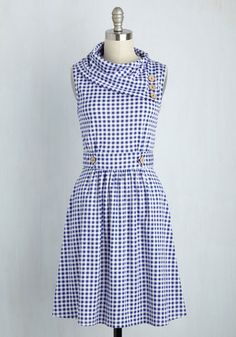 Coach Tour Dress in Gingham  Sometimes a dress is so magical, it makes you long for somewhere special and new to wear it. With stylish touches like a foldover, ascot-style collar and decorative, faux-wooden buttons, this indigo-and-white gingham frock steals all the attention away from the sights on your tour. Check out this dashing design in a host of other haute hues! The post  Coach Tour Dress in Gingham  appeared first on  Vintage & Curvy .  http://www.vintageandcurvy.com/produ..