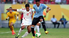 RECIFE, BRAZIL - JUNE 23: Abel Hernandez of Uruguay competes against Jonathan Tehau of Tahiti during the FIFA Confederations Cup Brazil 2013 Group B match between Uruguay and Tahiti at Arena Pernambuco on June 22, 2013 in Recife, Brazil. (Photo by Alex Livesey - FIFA/FIFA via Getty Images)
