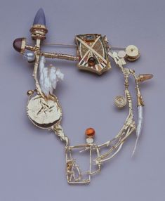 "William Harper, ""Grand Barbarian's Trapeze,"" 1998. Gold, enamel, pearls, gemstones. Newark Museum."