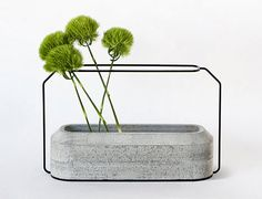 Vases with concrete bases and wire frame supports designed by Decha Archjananun