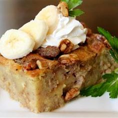 This rich banana-flavored bread pudding is made with coconut milk and sprinkled with toasted walnuts. It should sit 8 hours to overnight before baking, so it& a great make-ahead dessert. Just Desserts, Delicious Desserts, Dessert Recipes, Yummy Food, Yellow Desserts, Apple Desserts, Dessert Bread, Healthy Recipes, Cooking Recipes