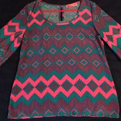 Tribal Blouse Fun blue and hot pink shirt! Very flowy and flattering, and has a cute little key-hole on the back! It is a size 4 and has never been worn!! Almost Pink Tops Blouses