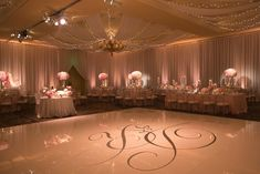 Large Monogram Dance Floor Photography: Marianne Lozano Photography Read More: http://www.insideweddings.com/weddings/pink-white-wedding-with-ombre-details-at-montage-laguna-beach/686/
