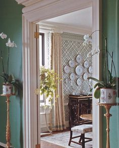 A pair of porcelain cachepots flank an entry to a dining room. trellis wallpaper and also add molding around living room entrance Vestibule, American Interior, Interior Decorating, Interior Design, Modern Wallpaper, Little Girl Rooms, Beautiful Interiors, Kitchen Interior, Home Projects