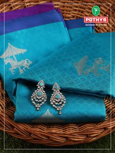 Vasundhara silk spreads its charm with a mind-blowing sea blue embroidered with intricate figures which run all across the saree. The saree is paired with a set of stunning stoned earrings. #ethnicsarees #ethnicty #silksaree #puresilk #saree #traditionalsaree #sareedesigns #sareestyles #weddingsaree #sareeaesthetics #sareelove #sareelooks #sareeforteenagers #blouse #blousestyles #blousedesigns #blue #sareeembroidery #luxurysaree #bestsarees #sareejewellery