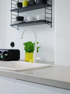 White Faucet; String Shelf
