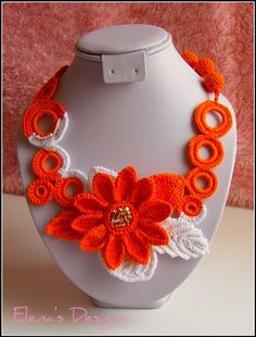 Attractive Jewelry set. Great for summer. Handcrafted with 100% cotton thread, and glass seed beads accent. Made with great love and care.The necklace closes with a orange crochet button. Colors: orange and white. Necklace length approx. 20 inches, flower size 3 inches Earrings: length with hook 2,2 inches, width 1,5 inches, gold plated hook Unique, will never be produced again. METRIC CONVERSION: http://www.sciencemadesimple.com/length_conversion.php The ite...