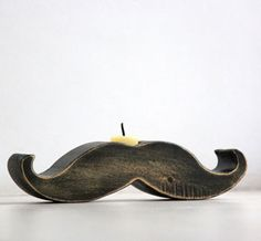 mustache candle holder.. again, when did mustaches become so popular? I need to make something with a stache on it!