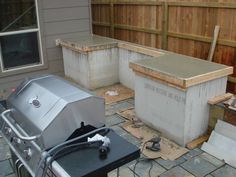 Simple Outdoor Kitchen With Concrete Countertops.