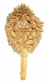 This corn dolly is known as a 'Bouquet de Moisson'. It consists of a diamond-shaped straw frame surrounded by a fringe of corn ears and spirally woven loops. The design of this dolly comes from Pas-de-Calais in France, and was introduced to England in the 1970s.  (MERL/86/120)