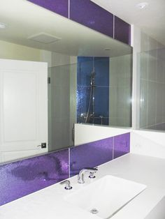 Purple Modono Glass panels used for accent wall in an upscale
