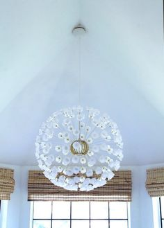 IKEA pendant lamp customized with small plastic cups hanging from a tall ceiling. Ikea Light Fixture, Light Fixtures, Sputnik Chandelier, Pendant Lamp, Chandeliers, Luminaire Ikea, Little Green Notebook, Woven Shades, Bedroom Lamps