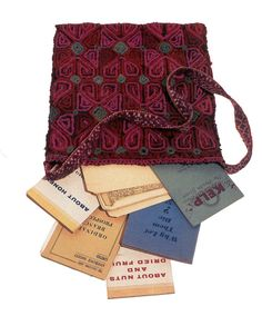 Maroon and pink shoulder bag in a floral motif containing assorted pamphlets and fan mail owned by Marilyn.