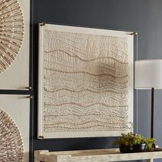 Coco beads, woven cotton, and twisted rope work together to create the beautiful Inverness Wall Decor.