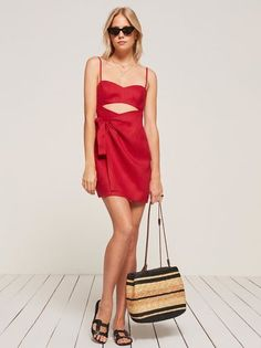 Cute dress with built-in ventilation, for summer. This is a mini length, wrap dress with a front bodice cut out and a sweetheart neckline.