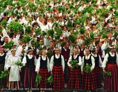 Women with tree garlands at a Latvian Song Festival