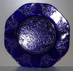American Sweetheart Blue by MacBeth Evans Glass Co. I am still searching for one of these plates to buy. Blue And White China, Blue China, Cobalt Glass, Cobalt Blue, Antique Glassware, Fenton Glass, Vintage Plates, Blue Plates, Glass Collection