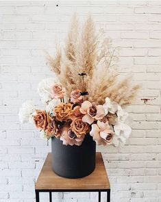 fact: pampas grass can compliment just about any space due to it's neutral color via Dried Flower Arrangements, Dried Flowers, Modern Floral Arrangements, Faux Flowers, White Flowers, Floral Wedding, Wedding Flowers, Wedding Centerpieces, Wedding Decorations