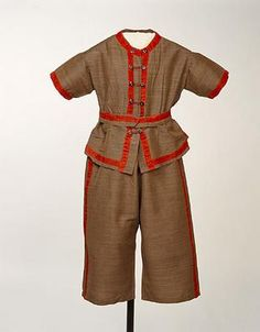 1870-1880 bathing costumes like this one-piece tunic and trousers were designed to cover virtually the entire body for modesty, in the event woollen fabrics clung to the body when wet.  My, how times have changed..