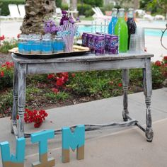 Coordinate your drinks with your summer party for added wow factor.  I bought these cute glass bottles at #HomeGoods and poured my drinks into them so they looked cute and it was easy for guests to serve themselves.  Tray and straws are also from #HomeGoods #HappyByDesign #HomeGoodsHappy #sponsored