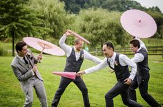 funny groomsmen photo with pink umbrellas, photo from http://www.gingerfoxphotography.com/
