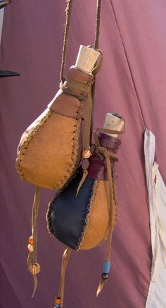 Small leather covered bottles by Laerad on deviantART