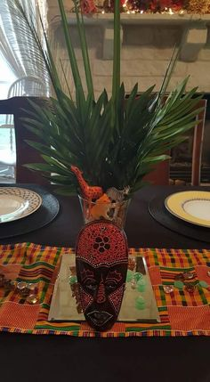 Black history month / love the centerpiece with the greens and love the mask, but would not include the animals. African Party Theme, African Wedding Theme, African Crafts, African Home Decor, Safari Party, Safari Theme, Tribal Theme, Traditional Wedding Decor, African Babies