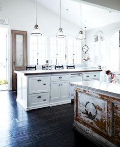 white kitchen, black floors, used wood
