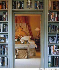 I love the books surrounding the door ~ Myra Hoefer
