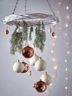 Carefully woven from natural grey willow with a rustic whitewash finish, our versatile willow wreath can be decorated with baubles, lights or DIY decorations to create a unique festive display. Each wreath includes a simple chain for hanging from the ceiling, zinc frame centre and ten small hooks around the wreath to make decorating easy.