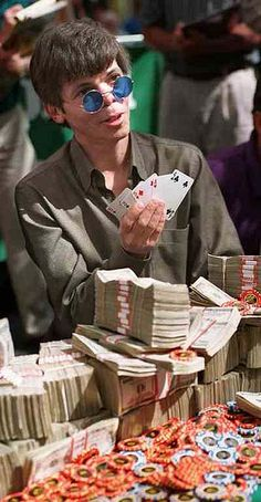 "Stu Ungar in May 1997 after winning $1-million in the World Series of Poker Main Event. It was his record-setting third win of the prestigious title. The round, cobalt blue tinted sunglasses, according to a biographer, were worn to ""hide the fact that his nostrils had collapsed from cocaine abuse."" 18-months later he died in a motel room from a heart condition brought on by years of drug abuse. Said to have won $30-million in his career, in cash and tournament games, he died with only $800 in his pocket."