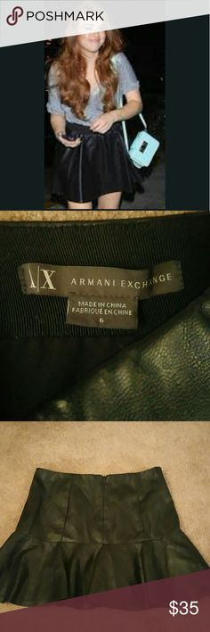"""New ARMANI EXCHANGE Faux Leather skirt **PIC #1,IS NOT THE SKIRT FOR SALE. IT IS MEANT TO GIVE YOU AN IDEA ON HOW TO PAIR IT UP**  New without tags. ARMANI EXCHANGE Black Faux leather skirt. Top part of skirt is flat and bottom part flares out. Sz 6. Waistline from side to side 15"""" Length 15"""" Armani Exchange Skirts Mini"""