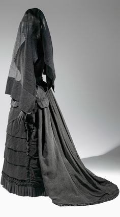 """The Metropolitan Museum of Art opens an exhibit called """"Death Becomes Her: a Century of Mourning Attire"""" on Tuesday, Oct. 21, 2014. This is a silk & mousseline mourning ensemble from the 1870s. Photo: Karin L. Willis/Met Click through for big picture"""