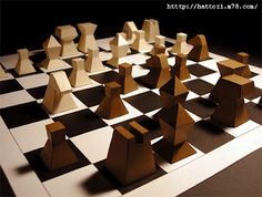 Chess pieces made out of cardboard