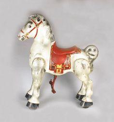 """Mobo Bronco"" tin ride on horse.  Pedal horse, was made in Kent, England, circa 1947."
