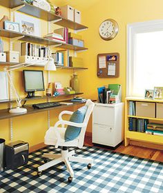 Started out by shredding documents to whittle down mountain of papers. Remaining papers were sorted into a file cabinet. Work pamphlets and materials were placed in boxes. A wall of shelving was installed to replace the desk. Its extra-long bottom shelf serves as a work space that accommodates two. For more ideas, see Real Simple's 21 Ideas for Organizing Your Home Office.