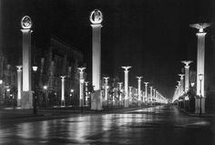 On the moonlit streets of Unter Den Linden in Berlin, the bystander is awed by the endless rows of Imperial columns, clearly glorifying the new and highly modern imperial government of the German Reich. In honor of the visit by the Italian leadership, the middle column is graced with the Fasces, an old Roman symbol which was adopted by Italian Duce, Mussolini, who fantasized restoring Italy to its former Roman glory.