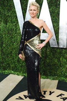 February 24 2013 -   Naomi Watts wore an Emilio Pucci asymmetric shimmering black sequinned gown with Jimmy Choo platform sandals and matching gold clutch to the Vanity Fair party.