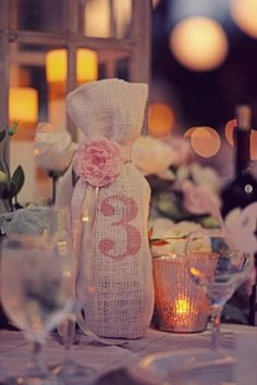 burlap wine bottle holder..  PRIZES FOR WEDDING because we aren't giving away the centerpieces.