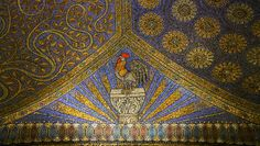 Rooster on the ceiling of Aachen cathedral. Charlemagne took inspiration from San Vitale in Ravenne when building Aachen Cathedral - back then only the Royal Chapel of Mary. The mosaics inside the church were only added in the late 19th, early 20th century and were clearly inspired by the Byzantine mosaics in the early Christian churches and monuments in Ravenna in Italy near Venice. The themes, colors, and patterns were clearly inspired by the Mausoleum of Galla Placidia.