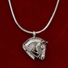 """This Dressage sterling silver horse head pendant measures 7/8"""" x 7/8"""" and is the perfect in between size for everyone to wear. It comes on a 16"""", 18"""", or 20"""" sterling silver snake chain with lobster clasp. Also available with a bead chain."""