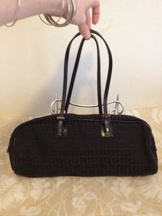 Hey, I found this really awesome Etsy listing at http://www.etsy.com/listing/162574764/fendi-vintage-90s-barrel-bag-stunning