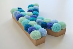 Pom Pom Letter - How to make a letter. Pom Pom Letter – Step 4 Informations About Pom Pom Letter Pin You can easily - Crafts To Make And Sell, Diy And Crafts, Arts And Crafts, Wooden Crafts, Pom Pom Crafts, Yarn Crafts, Diy Pom Pom Rug, Crafts For Seniors, Crafts For Teens