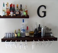 """Wall bar to save space.  Would love to do something like this with Ikea shelves and my """"R"""" cork holder."""