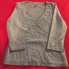 Ann Taylor Silver Beaded Sweater Size L Stunning Ann Taylor Silver Beaded Sweater size Lg. So gorgeous. I am unable to wear. Lightweight sweater. Shiny silver with great detail to beading around the neck and the sleeves (see pics) . A true showstopper!! Ann Taylor Sweaters V-Necks