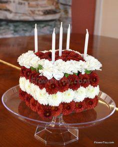 Birthday Cake with mini coronations. Cake made from fresh flowers.