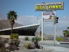 Former Tramway Gas Station which is now the Palm Springs Visitor's Center.  In the foreground, the old Palm Springs Aerial Tramway sign.