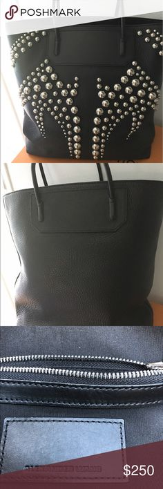 Alexander Wang Studded black Handbag Beautiful ladies black studded tote by Alexander Wang!! Pebbled leather with silver studs on the front.   Great condition.  Only used a few times. One zippered pocket on the inside along with two open pockets on the inside.  Eye-catcher. Alexander Wang Bags Totes